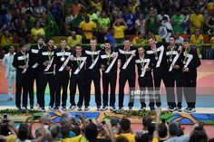 Silver medallists Italy pose on the podium after the men's Gold Medal volleyball match at the Maracanazinho stadium in Rio de Janeiro on August 21, 2016, at the Rio 2016 Olympic Games. / AFP / Johannes EISELE