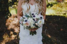 Romantic garden bridal bouquet. Wedding colors in ivory, blush, gold, and sage. Anemones, ranunculus, roses, eucalyptus, dusty miller.  Floral Design: www.papertini.com Photography:www.lovemedophotography.com