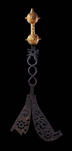 Africa | Ceremonial sword from the Ashanti people of Ghana | Metal with dark patina, wood handle covered with gold foil