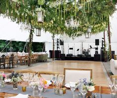 A gorgeous live ceiling transforms this white outdoor wedding tent from drab to fabulous!