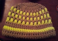 Crocheted baby hat with the puff stitch