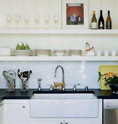 kitchen: farmhouse sink, white cabinets, soapstone countertops