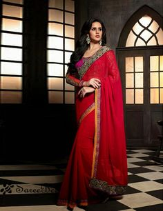 ThisDesigner Red georgette party wear Bollywood sareeis including the wonderful glamorous showing the feel of cute and graceful. The embroidered and patch border work over a dress adds a s...