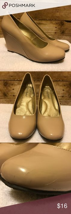Pierre Dumas, 10, nude/ tan wedge glossy  heel Pierre Dumas size 10 . Nude / tan wedge patent leather  heels, glossy finish, gently worn. Light scuff imperfections pictured on left toe and wedge. Only noticeable upon close inspection. Pierre Dumas Shoes Wedges