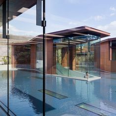 Named Daeyang Gallery and House, the copper-clad building has two pavilions that rise up above the water to provide an entrance and an event space for the private gallery, while a third is the home of the owner.