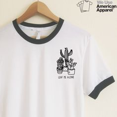 This adorable cactus design is one of our favorites. We use authentic American Apparel ringer tees.   Our ringer tees are a staple to any girl's closet, adding a touch of grunge. They look great styled casually with jeans and boots, or dressed up with a cute plaid skirt.  Unlike other Poly-Cotton t-shirts on the market, ours is made with combed cotton, giving it an ultra soft, worn in feel and superior drape.