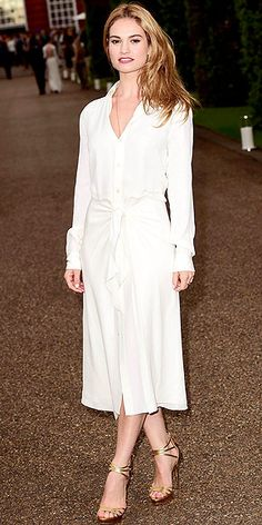 Last Night's Look: Love It or Leave It? Vote Now! | LILY JAMES | in a cream Ralph Lauren Collection blouse and flowy midi skirt at the Ralph Lauren and Vogue Wimbledon Summer Cocktail Party in London.