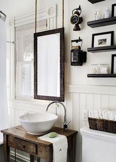 We love this idea of suspending a mirror!     (Victorian bathroom remodel featuring mirror hanging on chains by Antonio Martins Interior Design)