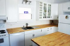 A fresh white Ikea kitchen was installed to brighten up a dated space. Everything was replaced and new flooring and a tin ceiling complete the look White Ikea Kitchen, Tin, Kitchen Cabinets, Ceiling, Flooring, Fresh, Space, Home Decor, Floor Space