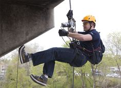 A team of engineering students has created a working Batman-inspired, grappling hook-shooting, power winch-equipped wall-scaling device. Tactical Survival, Tactical Gear, Survival Gear, Power Winch, Climbing Harness, Rock Climbing, Air Cannon, Grappling Hook, Spy Gear