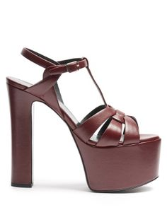 Saint Laurent's burgundy leather Betty sandals fuse glam-rock nostalgia with a touch of polish. They're crafted in Italy with intertwining front straps that encase the foot, and lifted on a towering platform and block heel. Watch them bring 1970s impact to after-hours looks.