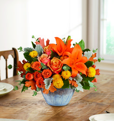 You'll #fall in love with this #centerpiece this golden bounty of #roses and #lilies, arranged in a gorgeous oven-to-table ceramic bowl. It's finished with an eye-catching artisanal glaze in shades of steel blue--the perfect mix of pretty and practical! This #arrangement features #OrangeRoses, orange spray roses, #OrangeAsiaticLilies, yellow cushion spray #chrysanthemums, dusty miller, lemon leaf, and parvifolia #eucalyptus. Delivered in Teleflora's Bountiful Blessings Bowl. Starting at…