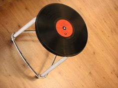 Repurpose an old stool frame with a vintage 78 album glued to a round wooden base that is painted black.  http://www.flickr.com/photos/28977837@N03/2955042817/