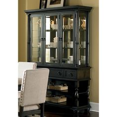 The gorgeous Loraine buffet and hutch are the perfect accent for your dining room offering storage space and a beautiful display cabinet for your finer items. Features glass shelves with plate grooves in the back and touch lighting.