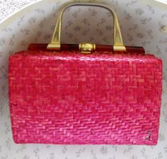 Vintage handbag in very good condition. The 1960's style bag. The red wicker is lacquered with one slight break (shown in photo.) The interior has no rips, a single pocket and opens wide. A fabulous wicker purse for summer.  $22.99 on Etsy.com Click link to buy it: https://www.etsy.com/listing/154305324/red-wicker-handbag?ref=shop_home_active
