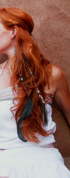 feathers and beads woven into her locks, beautiful naturalistic look