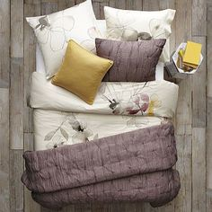 I have always loved purple!  Combine it with mustard yellow and it's exquisite! Layered Bed Looks - Flower Bed #WestElm