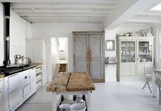I like this farm-table-y island and the whitewashed + wood + iron hardware accents