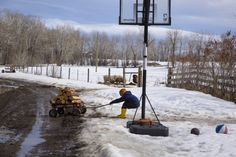 Montana's Spring Lambs - Chores come in all shapes and sizes. Hazen makes an effort to pull wood on a wagon through the mud. Credit: Jamie Francis | © The Weather Channel