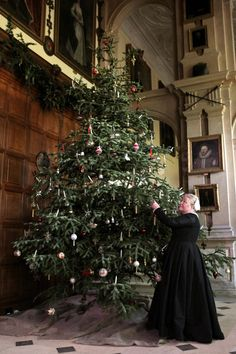 RMG Photography - 19th November 2011 Christmas preperations at Audley End House. Housekeeper, Mrs Warwick puts the last decoration onto the Christmas Tree. Pic - Richard Marsham RMG Photography 23 Millfield Littleport Ely Cambridgeshire CB6 1HN Tel : 07798 758711