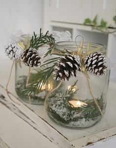 Winter candles, pine cones and mason jars
