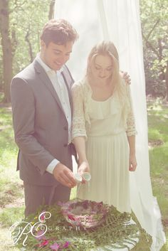 A beautiful woodland wedding water ceremony with a wildflower style iced bowl.