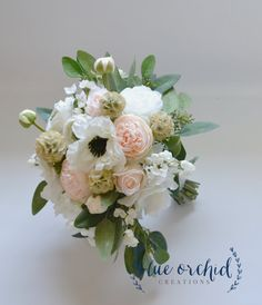 This wedding bouquet is one of our deluxe designs. This bridal bouquet is full of pink, blush and cream colored peonies, ranunculus, hydrangea, and anemones. The silk flowers are separated by sprigs of wildflowers and seeded eucalyptus. The shape of this bouquet adds to its unique