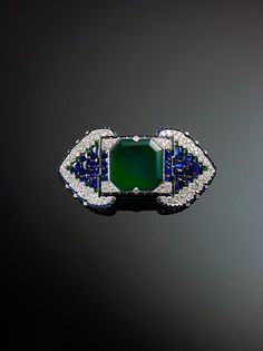 Belt Brooch, Cartier, Platinum, set with emeralds, sapphires, and diamonds