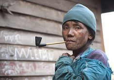 Smoke break: Nearly all the women smoke pipes, although their frequent smoke breaks don't seem to affect their ability to move around