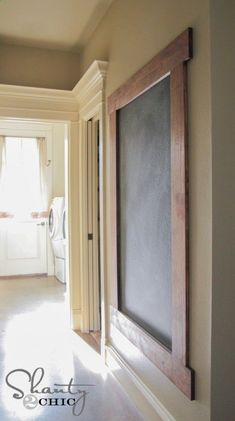 DIY: Framed Chalkboard Wall Tutorial - this shows how to construct the frame   how to prep  paint the wall with chalkboard paint. The painted wall concept would also work if you have an unused frame.