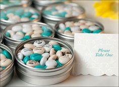 Favor tins filled with personalized M&M'S in your wedding colors will make the reception complete.