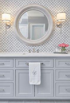 Master bathroom marble mosaic vanity tile backsplash with gray painted vanity, lights and round mirror - Home DIY Idea Grey Bathroom Tiles, Bathroom Colors, Small Bathroom, Master Bathrooms, Marble Bathrooms, Bathroom Ideas, Silver Bathroom, Design Bathroom, Bath Design