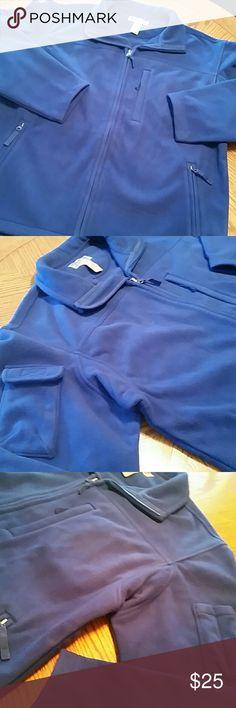 New Duluth Trading Co jacket New in bag! Never worn. Royal blue. Fleece jacket. Men's large. 100% polyester. 2 inside pockets plus one zippered inside pocket. 3 zippered pockets on outside plus pockets on sleeves. Duluth Trading Co  Jackets & Coats