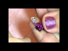 This week Kelly from Off the Beaded Path brings to you another great beading project. She shows you how to make a beautiful yet easy bracelet.  Materials needed for this project are:    (69) - 4mm Bicones. ( Kelly used Fuchsia )  (82) - 4mm Firepolish Rounds ( Kelly used purple iris)   (2 Grams) - Size 11 Seed Beads ( Kelly used Purple )  (2) - Wire P...
