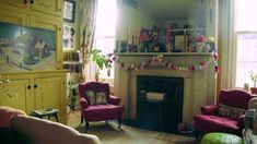 Amy Sedaris' apartment is a warren of whimsy and individuality reflective of the owner. Here is a look through the wonderland. Cream Chest Of Drawers, Greenwich Apartment, Yellow Cupboards, Leather Poof, Green Leather, White Rocking Chairs, Amy Sedaris, Chimney Breast, Celebrity Houses