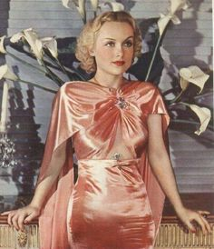 Carole Lombard - love the beautiful coral colour and fabric of her dress