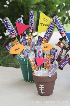 How to make a football candy bar bouquet for football season. Click here for directions on how to make an easy football candy centerpiece.