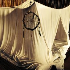 Bohemian canopy bed with dream catcher