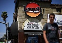 Sign in honor of the late Robin Williams at the Laugh Factory comedy club in Hollywood, Los Angeles, California August 12, 2014.  REUTERS-Lucy Nicholson
