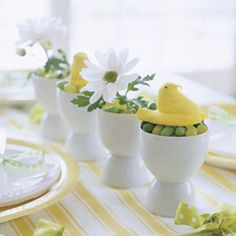 Bring some fun to the kids' table with zero-fuss decorations as irresistible as they are indestructible. For the centerpiece, fill white plastic egg cups with green jelly beans, then add marshmallow chicks and mini daisies. The no-sew tablecloth is equally easy: Use a crafts store grommet kit to punch holes at the edges of kitchen towels, then join them all together with ribbon bows.