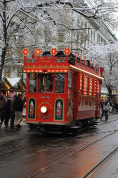 This is Zurich, Switzerland, at Christmas.  I love the 'Fairy Tale Tram' that is depicted in this photograph.