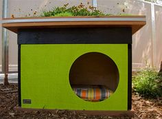 Love this idea- Homemade doghouses with planters on top