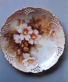 overglaze mineral paint on porcelain, wild roses by Jean Sadler