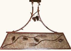 """This pool table light is made of etched iron and mica. It is perfect for any country or rustic look. The pine cones are cut and hammered to shape. UL listed for eight 60 watt bulbs. 18"""" Width X 48"""" Length."""