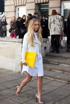 25 Shirtdress Outfit Ideas for Spring - a crisp white shirtdress styled with a white leather jacket, silver metallic ankle strap heels, and a yellow oversized clutch Shirtdress Outfit, Estilo Blogger, Fashion Blogger Style, Girl Fashion, Fashion Bloggers, Fashion Spring, Fashion Outfits, Fashion Story, Fashion 2018