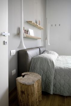 wood stump bedside table and bare wood shelves. ummmm...make cushions for the headboard....yeah Im gonna try that !!!!