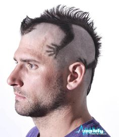 A funky men's mohawk haircut. This hairstyle is a mohawk cut to look like an iguana or lizard. Length at the back was left to resemble the tail.