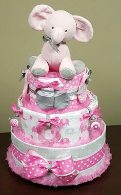 Pink and gray baby girl elephant diaper cake! Baby shower gift! See more on my Facebook page, Simply Showers.  https://m.facebook.com/adorablegifts