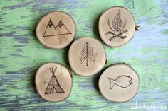 outdoor designs woodburned on wood slices