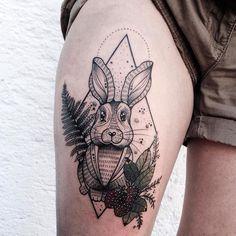Geometric bunny tattoo with plants
